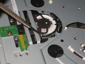Bend these small pieces down to stop the Wii disc drive's loud noise.